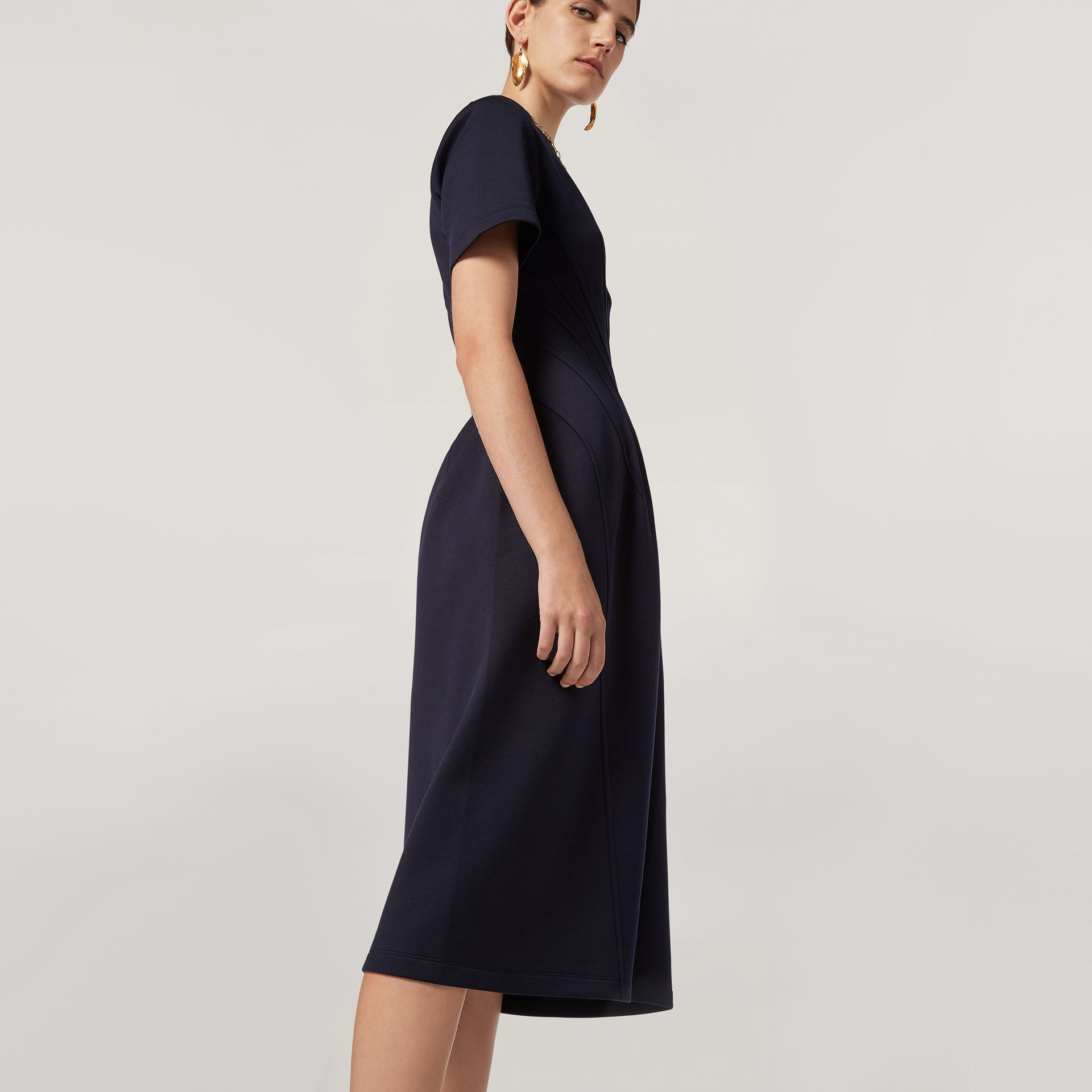 Model wears a blue dress from the Resort 2020 collection