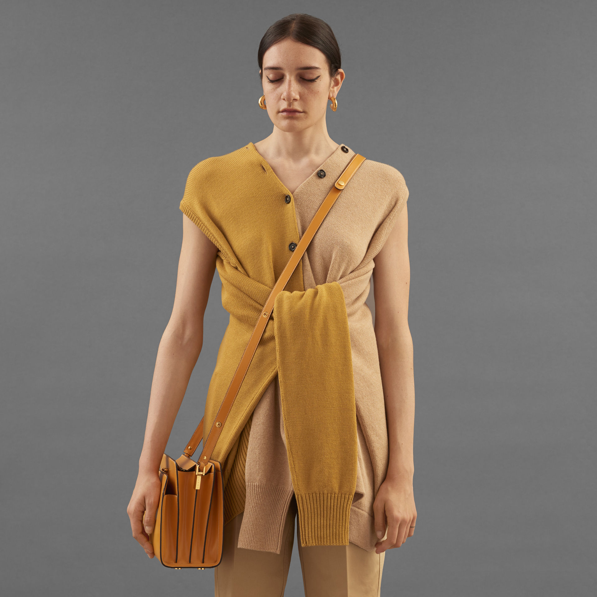 Model wears a yellow sweater from the Resort 2020 Collection
