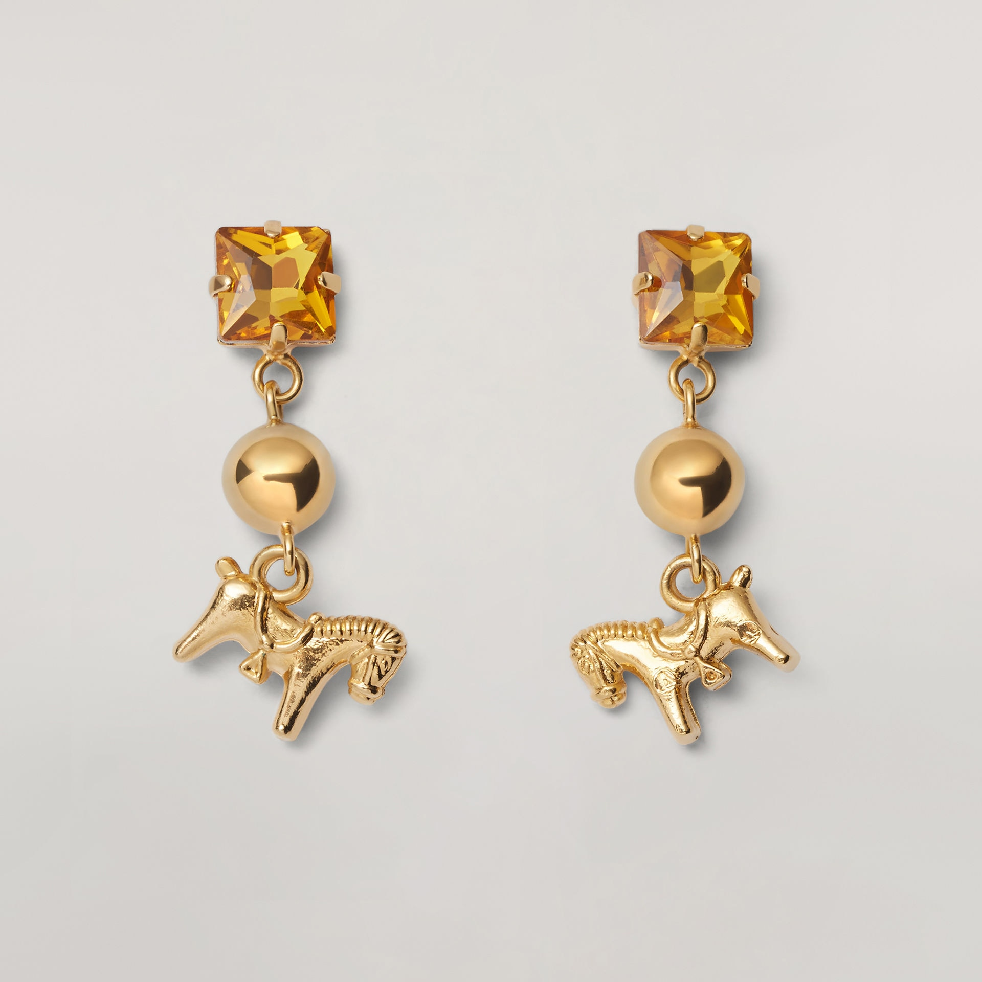GIGA JACKS EARRINGS IN METAL AND GLASS WITH PONY-SHAPED PENDANT