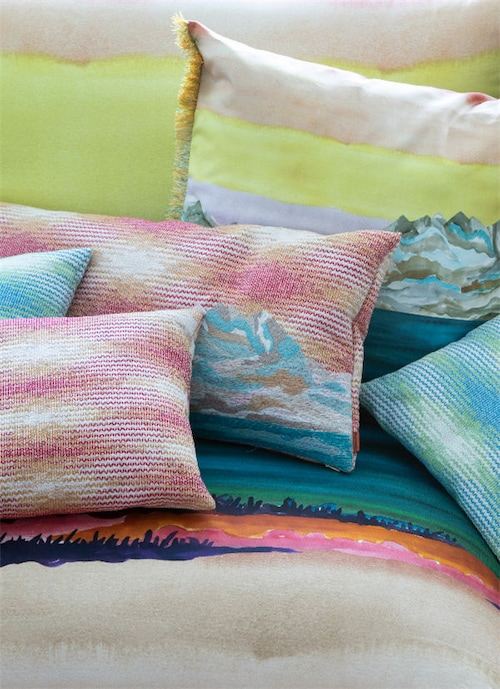A lineup of cushions in pastel tones, inspired by snowy mountain tops.